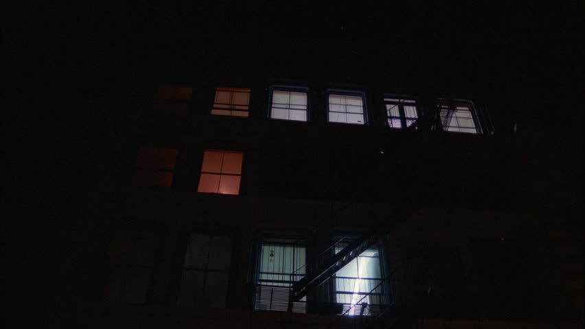 night up angle blue gray 5 6 story loft apartment building big windows, fire escapes holds then tilts down entrance pillars closed art gallery , older 1980's pick up truck parked front New York