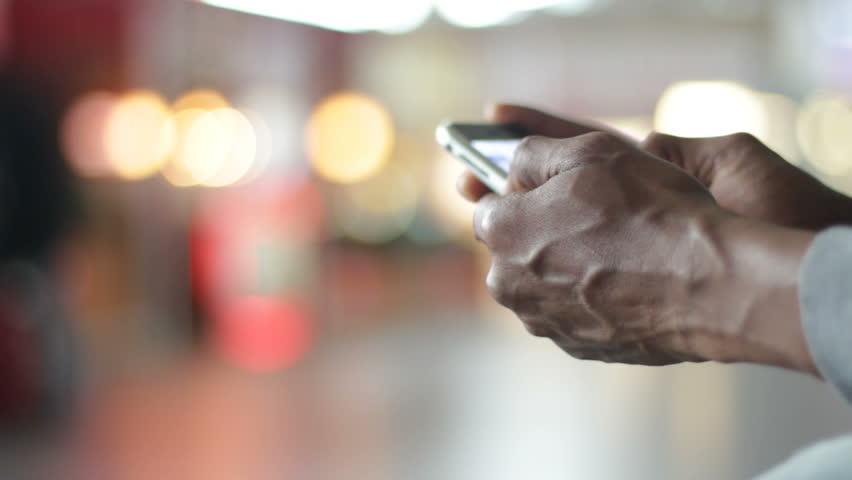 Man holding cell phone | Shutterstock HD Video #1976416