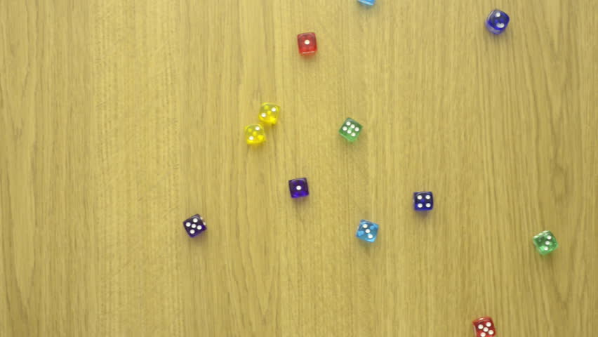 Colorful dice on wooden table. Concept film clip of risk, chance and leisure game. | Shutterstock HD Video #19794256