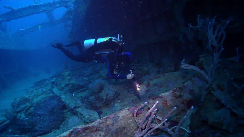 Male model scuba diver hovering on wreckage in Solomon Islands, HD, UP18934   Shutterstock HD Video #19798753