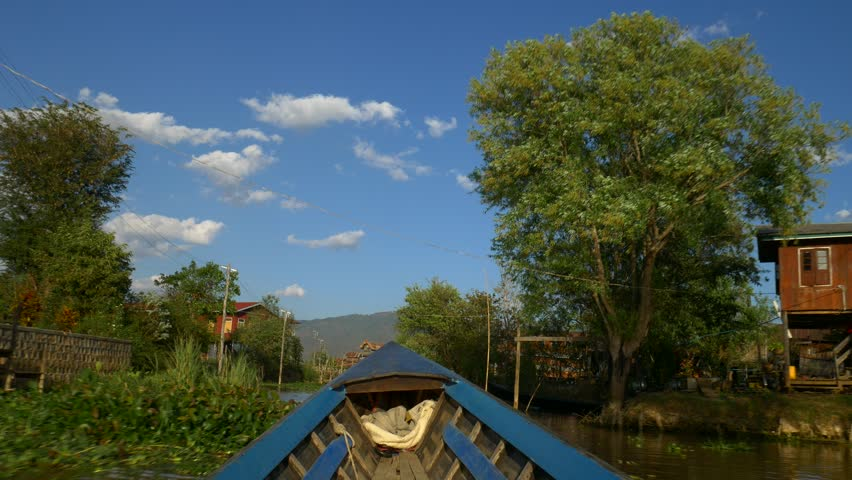 Boat going through traditional floating village, Inle Lake, Myanmar | Shutterstock HD Video #19805626
