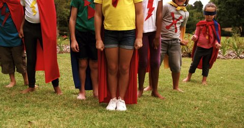 Group of kids pretending to be a super hero in the park 4k