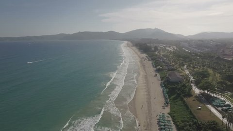 Aerial flight over Yalong Bay, a popular holiday destination in the Sanya region, particularly known for its vast number of luxury hotel resorts, Hainan island, South China Sea.