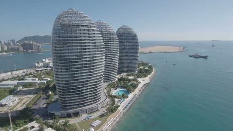 SANYA, CHINA - JULY 2016: Panoramic aerial drone shot of a luxurious hotel resort and entertainment complex, built on an artificial peninsula in Sanya, on tropical Hainan island in South China Sea.