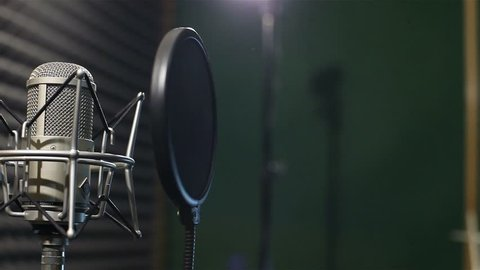 Studio recording, professional microphone in the recording studio, microphone near wall with acoustic dampening foam, Shallow depth of field,