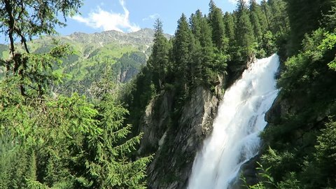 Krimml Waterfalls in Pinzgau, Salzburger Land at Austria. European Alps landscape with forest.