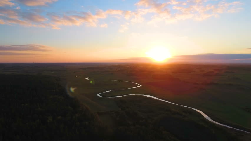 Flight above the picturesque green landscape,river, ground, grass. During sunset.  Aerial View.   Shutterstock HD Video #19884526