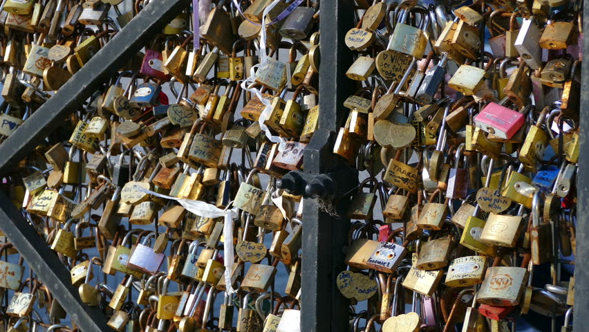Paris, France: Hundreds of love locks attached to a metal fence next to Pont Neuf bridge over the River Seine. | Shutterstock HD Video #19899166