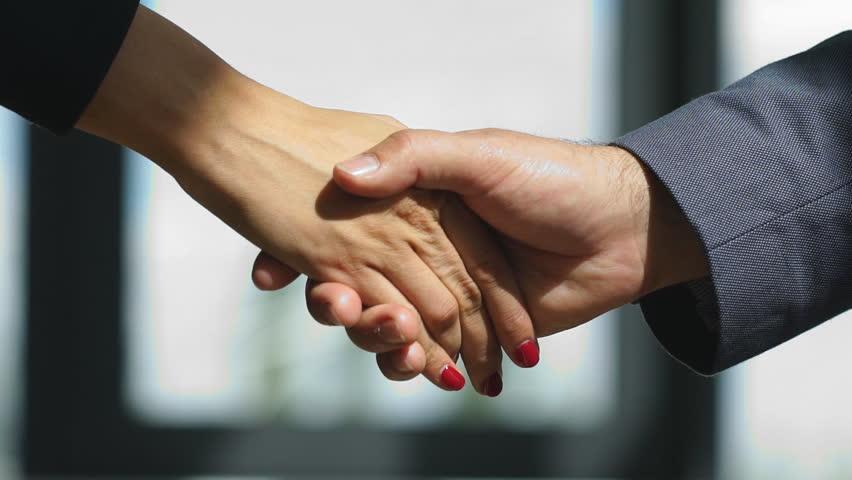 Video businessmans handshake. Successful businessmen handshaking after good deal