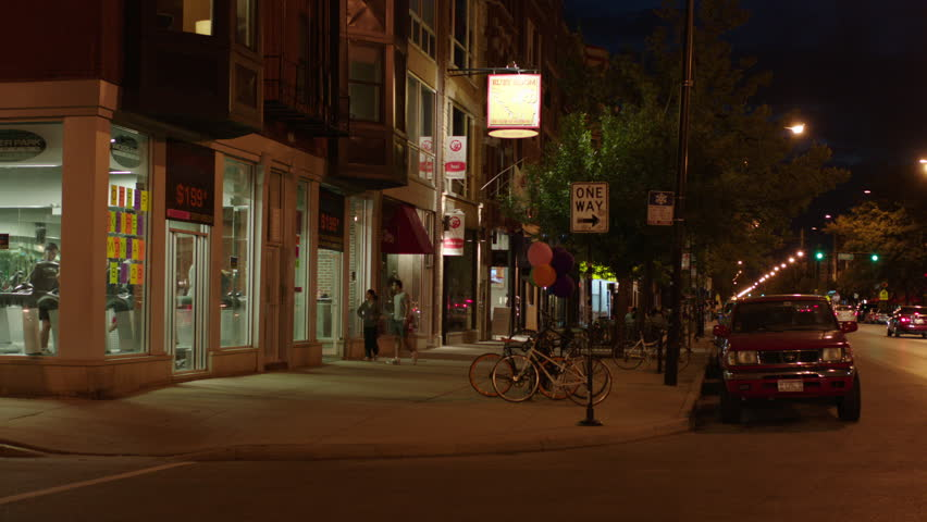 Night hold down sidewalk patio cafe restaurants, couple enters gym then left corner health club fitness gym big windows see people exercising inside Wicker Park Fitness Chicago, girl dog around co | Shutterstock HD Video #19921606