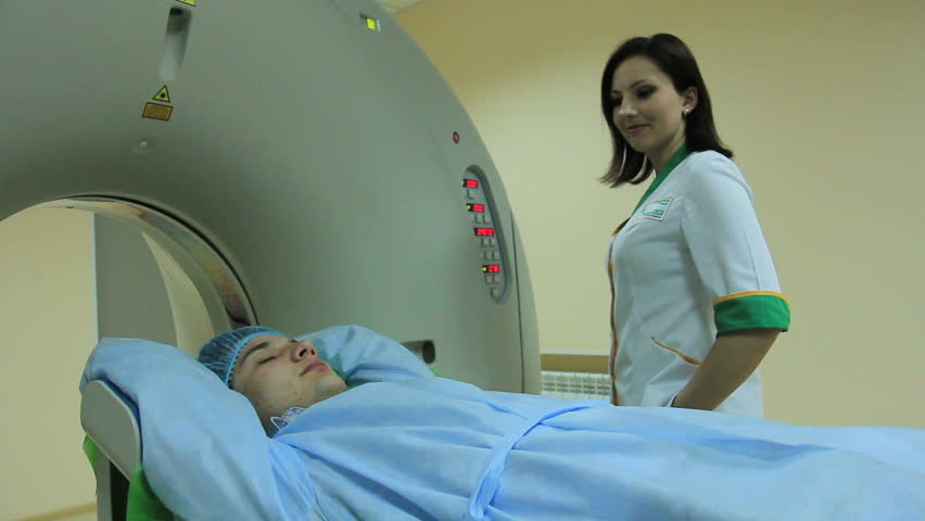 The Docter launches an MRI scannner CT  #19936786