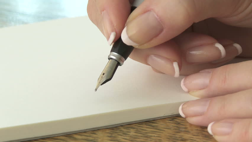 Writing a letter with a fountain pen
