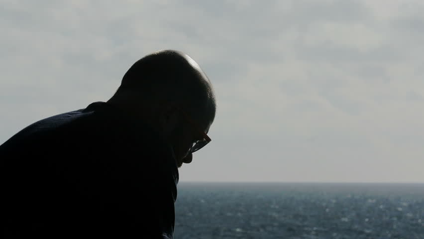 Portrait of depressed young man thinks about her dead father in front of the sea #19950706