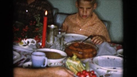 COTTONWOOD, ARIZONA 1968: carving a ham at a family christmas dinner