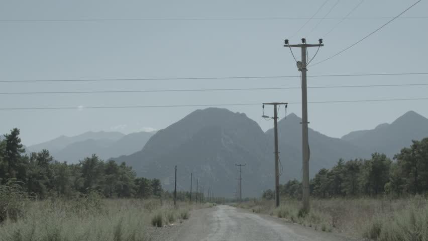 Antalya, Turkey, Summer 2015 Truck driving by towards the mountains, Black Magic Cinema Camera EF | Shutterstock HD Video #19987348