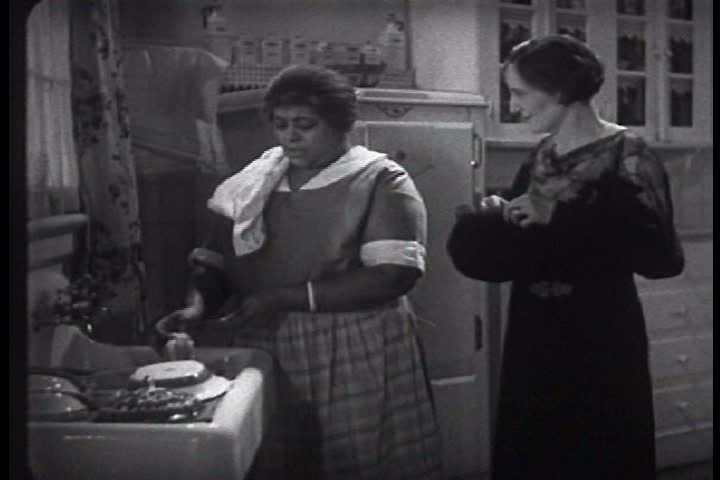 An African American maid gossips with the woman of the house, in a piece of romance fiction by Beatrice Burton Morgan, in 1935. (1930s)