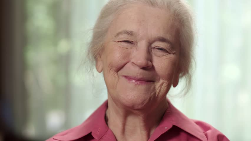 Close up of a happy elderly senior woman smiling. Shot in 4K UHD. | Shutterstock HD Video #19998196