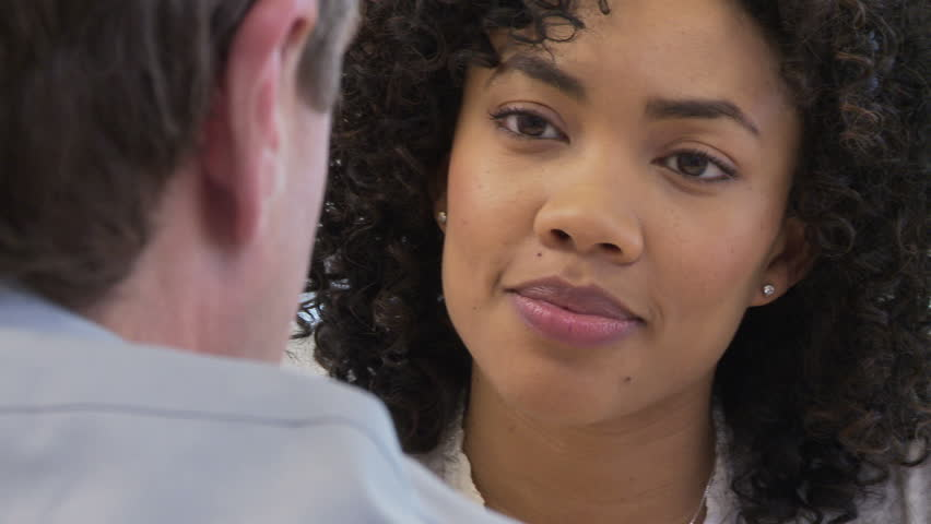 Close up faces of two business people talking   Shutterstock HD Video #2001875