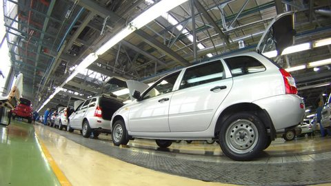 TOLYATTI - SEP 30: (Timelapse View) Cars are move on pipeline in assembly shop on plant AUTOVAZ, on Sep 30, 2011 in Tolyatti, Russia