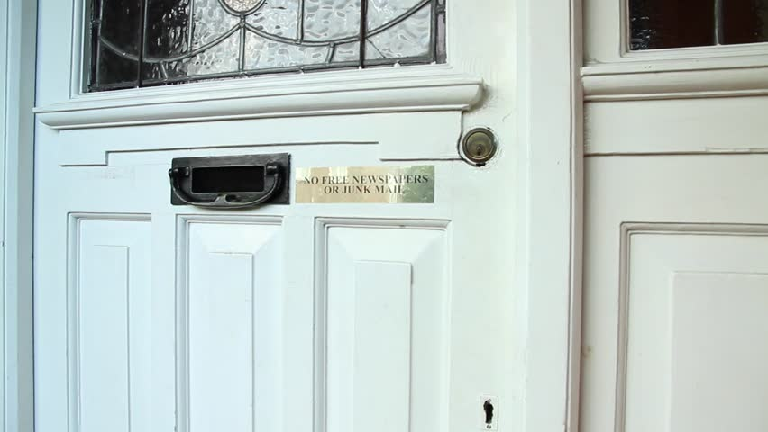 The girl comes out of the door of the house and leaves. | Shutterstock HD Video #20102686