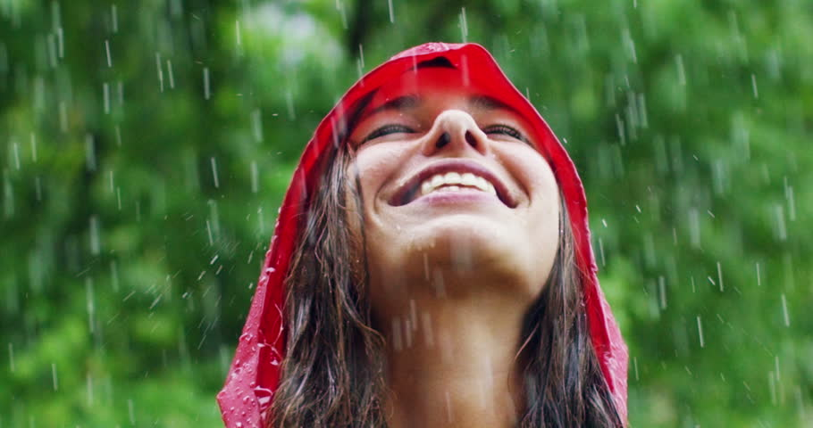 Girl smiles and laughs in the rain. the rain falls, the drops fall on his face and the girl is happy with life and nature around. concept of nature and happy life. Adventure, purity. | Shutterstock HD Video #20125156