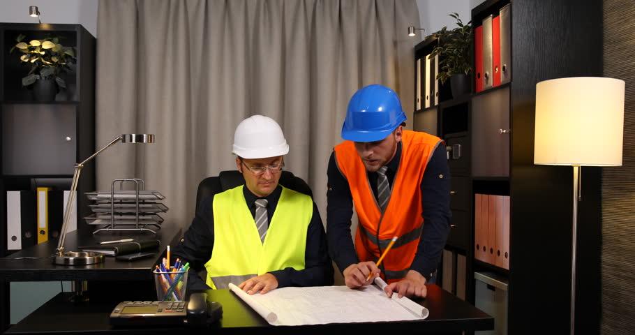 Team of engineers men planning blueprint plans teamwork caucasian engineer men looking plans and analyzing teamwork inside meeting room ultra high definition malvernweather Choice Image