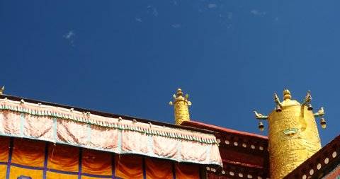 4k closeup of The Jokhang Temple In Lhasa,Tibet,white clouds in blue sky. gh2_09661_4k