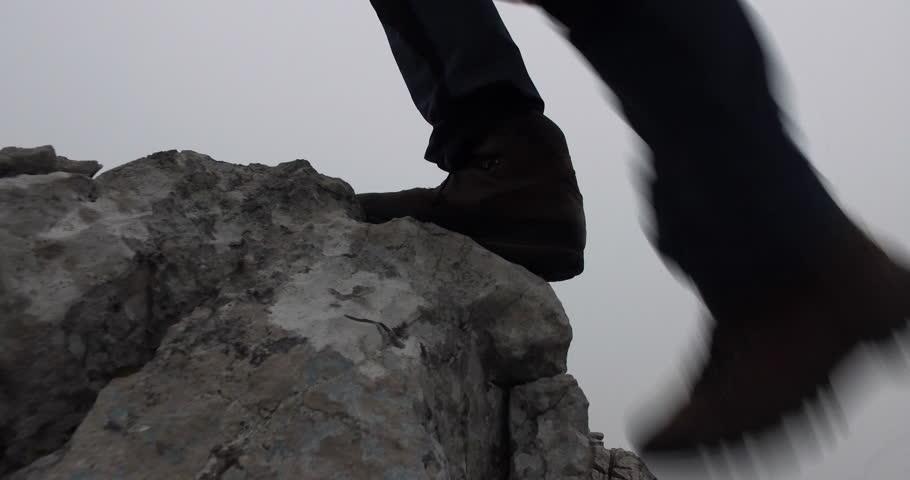 Mountaineering boots steps on rock   Shutterstock HD Video #20174854