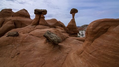 Motion controlled tracking time lapse with dolly in, tilt up & zoom out motion of Toadstool Hoodoos in Utah