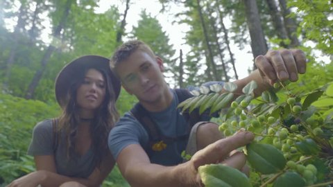 Man Collects Berries In Forest, Shares Them With His Girlfriend (Slow Motion)