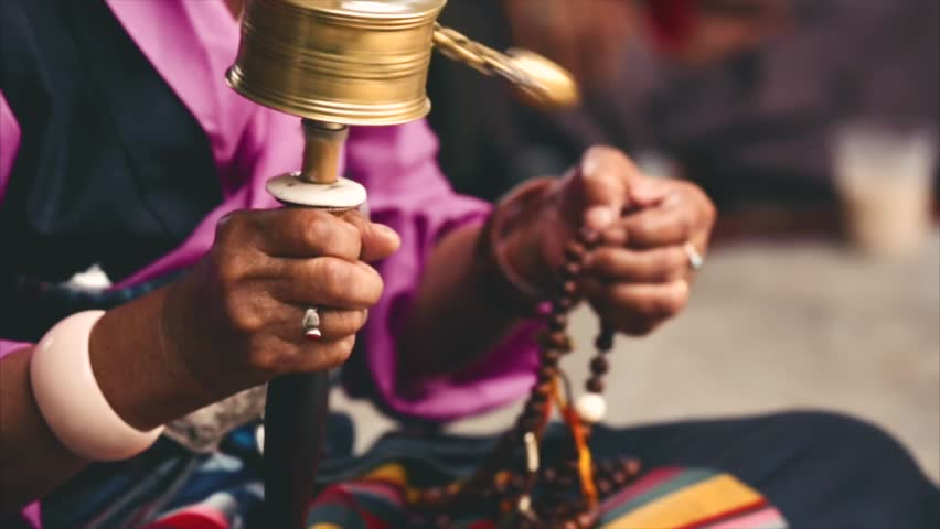 Buddhist prayer wheels, the ceremony at the temple. Woman pilgrim twisting prayer wheels. Closeup. Boudhanath, Kathmandu, Nepal.   Shutterstock HD Video #20217526