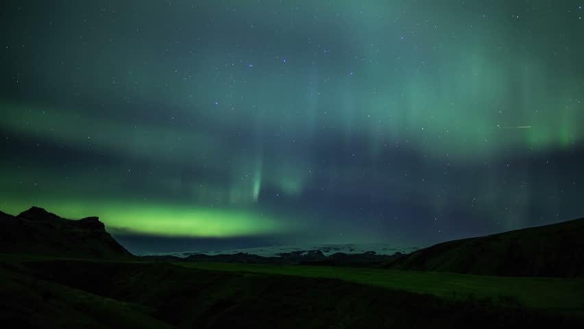 Aurora borealis northern lights over snow ice cap glacier Iceland realistic 4k