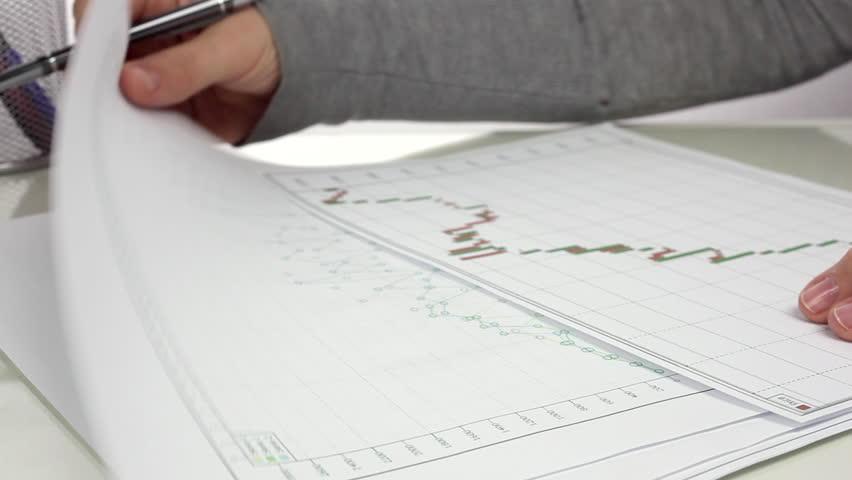 Businesswoman performs analysis of financial statements. Close up/Analysis of Financial Statements | Shutterstock HD Video #20240194