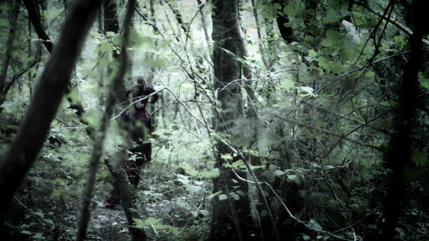 4k Halloween Shot of a Child in Joker Costume Running in the Forest