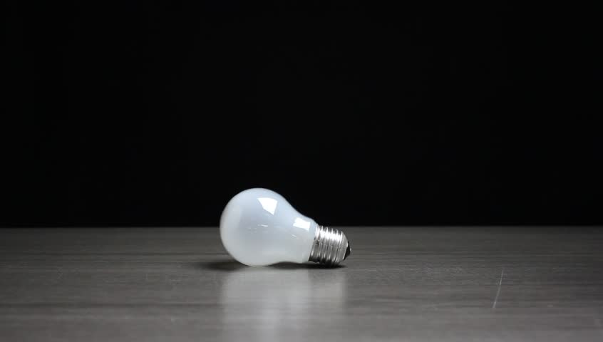 New economy CFL lamp changing old lamp | Shutterstock HD Video #20284366