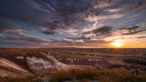 Beautiful movement of the clouds over the chalk hills. Sunset. Timelapse