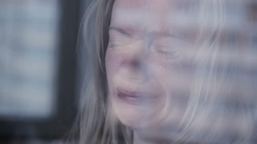 Sad girl near window. plachet woman. tears in schekah | Shutterstock HD Video #20356696