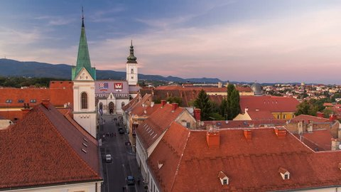 Church of St. Mark day to night transition timelapse and parliament building Zagreb, Croatia. Top view from Kula Lotrscak tower before sunset