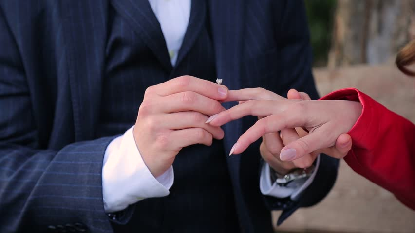 Groom Wears Wedding Ring On Womans Hand Bride Ceremony Flower Stock