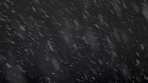 Slow motion footage of snow falling isolated on a black background...