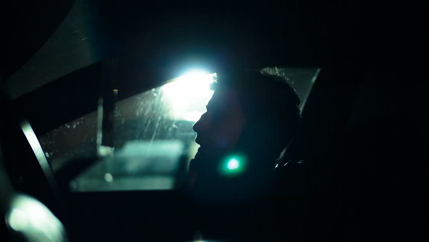 Profile of a man in a car on a dark night. Noir style | Shutterstock HD Video #20416066