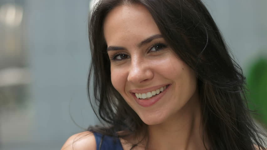 Beautiful lady smiling on camera. | Shutterstock HD Video #20428624