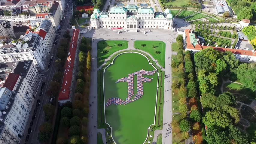 VIENNA, AUSTRIA - OCTOBER 09, 2016: Lower and Upper Belvedere Palace with Beautiful Garden, Flowers.  Two Baroque palaces, the Orangery, and the Palace Stables. Belvedere museum
