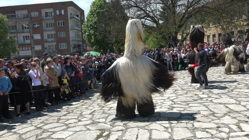 RAZLOG, BULGARIA - 07 MAY, 2016: Participants are participating in the Eastern International Festival of dolls. The festival promotes variations of ancient Bulgarian masks and folklor