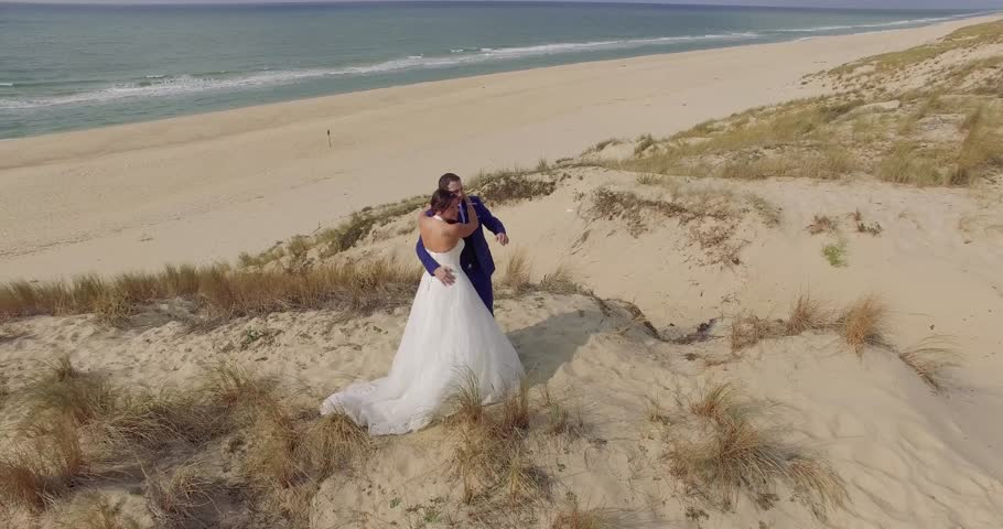 Bride and groom by the sea on their wedding day  | Shutterstock HD Video #20446096