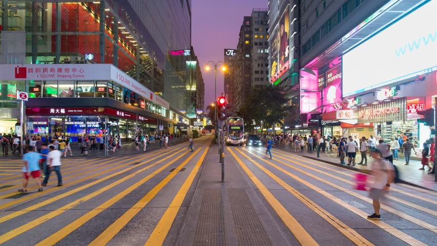 Time lapse of pedestrians and traffic at a busy road crossing, Nathan Road, Kowloon, Hong Kong, China (Jul 2016, Hong Kong)