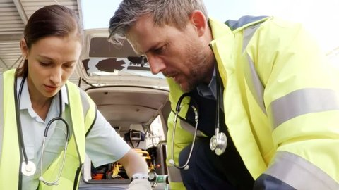 Paramedic using an external defibrillator during cardiopulmonary resuscitation in hospital