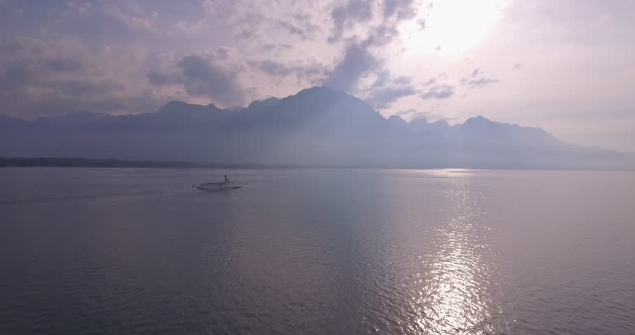 Transportation boat on Geneva lake, Switzerland Mountains in background. Drone DJI Phantom 4 - 4K - 24fps - 29 sec.