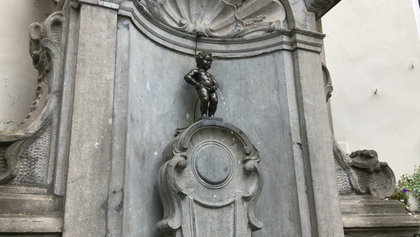 Brussels Belgium EUROPE 7 OCT 2016: pan tilt up camera motion video of Manneken Pis or small peeing, pissing boy bronze sculpture, statue, fountain is famous Bruxelles sightseeing, travel landmark