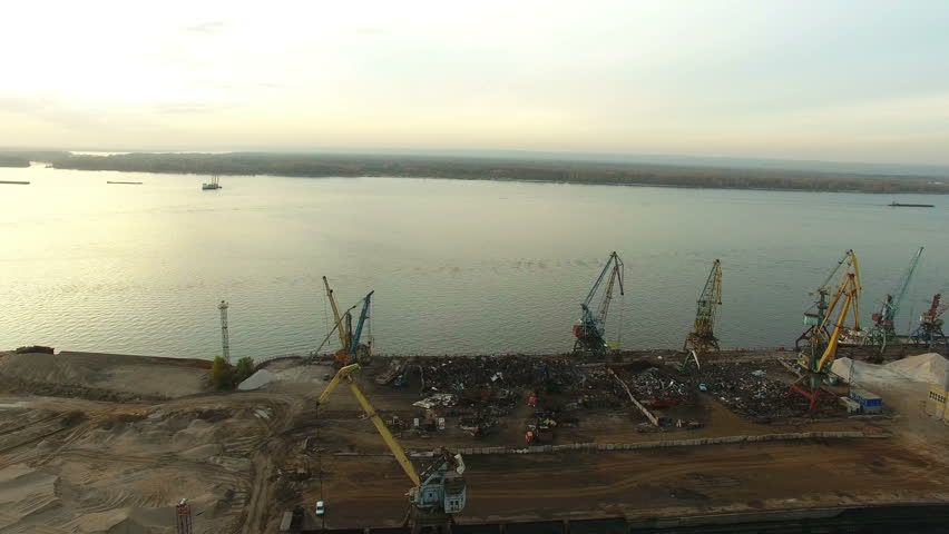 Flying over Samara city docks and cranes at estuary. Samara river flows into the Volga river. Drone moving forward at high altitude. 4K Aerial stock footage clip. | Shutterstock HD Video #20528716